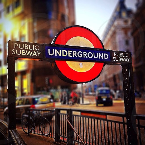 public subway underground black blue red and white sign photo