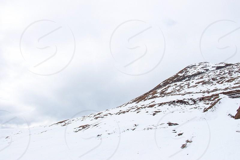 photo of snowy mountain during daytime photo