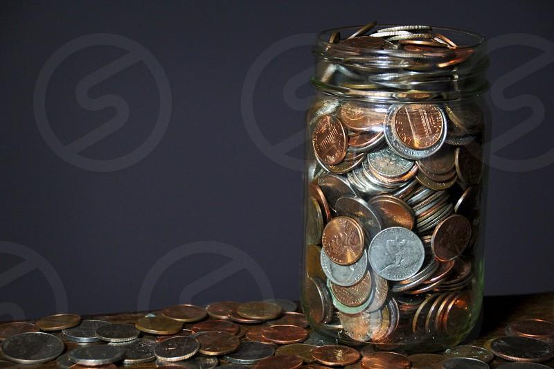 Finance Savings Currency Jar Money Jar US Currency Collection Coins Savings Jar photo