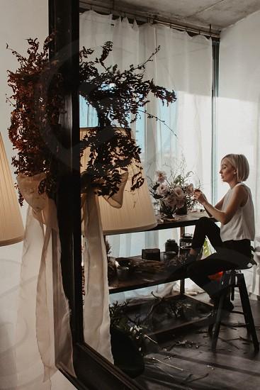 Mirror florist girl handmade reflection working in process photo