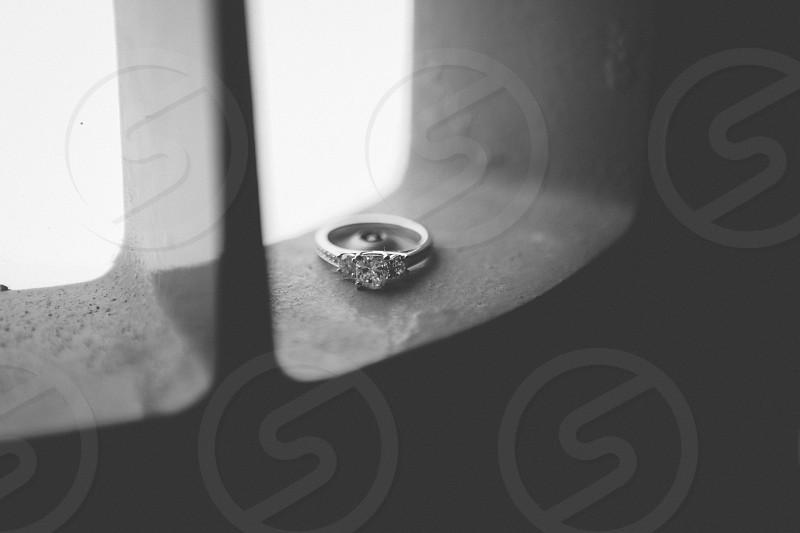 gray scale photo of silver diamond ring photo