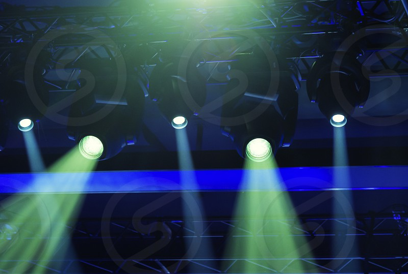 stage spotlights projecting lights during a live event. Live concerts and events photo
