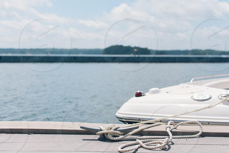 white speedboat wrapped on gray steel hook photo