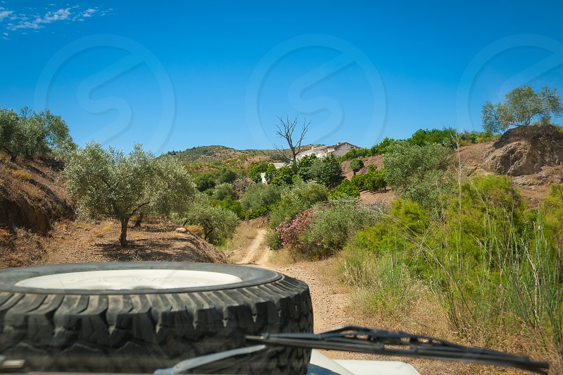 View from driver seat in 4x4 vehicle while driving through countryside. photo
