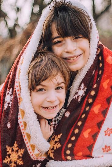 Boys brothers blanket cozy winter Christmas cute hug love joy cold warm photo