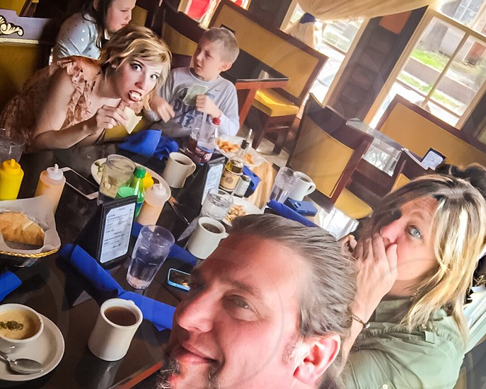 Family Together Exploring New Place To Eat Food photo