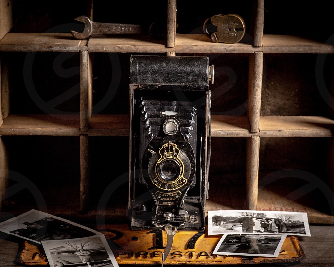 Old vintage camera surrounded by antiques photo