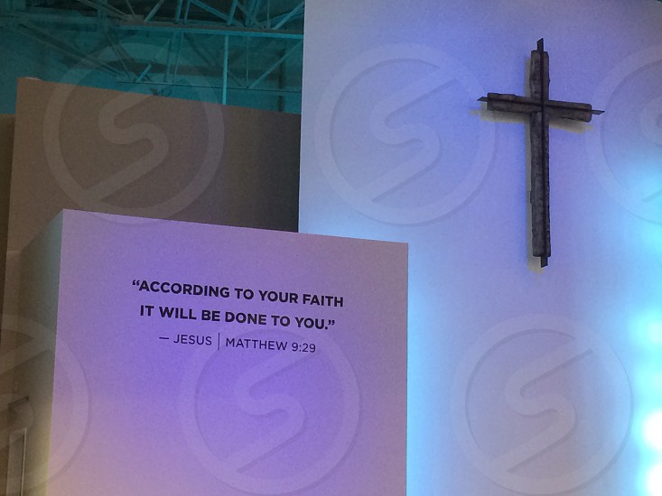 According to Your Faith it Will be Done to you. -Jesus  Matthew 9:29 decorative board beside brown cross photo