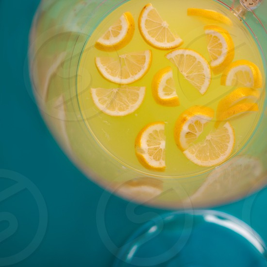 Lemonade; beverage; drink; summer; refreshing; yellow; blue; lemons photo