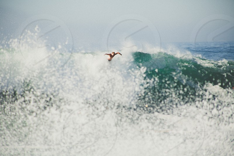 man diving on sea wave photo