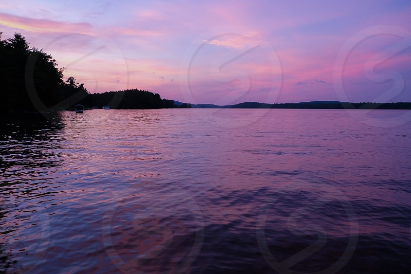 Purple sunset on Great Pond Belgrade Lakes Maine; lake sunset; pink clouds photo