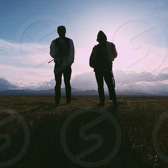 two man on green grass field photo