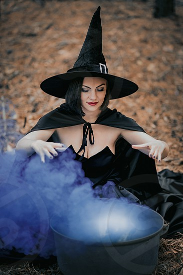 Witch in autumn forest  photo