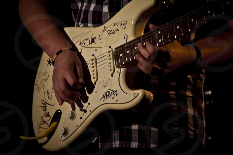 Close-up shot of an Electric Guitar being played photo
