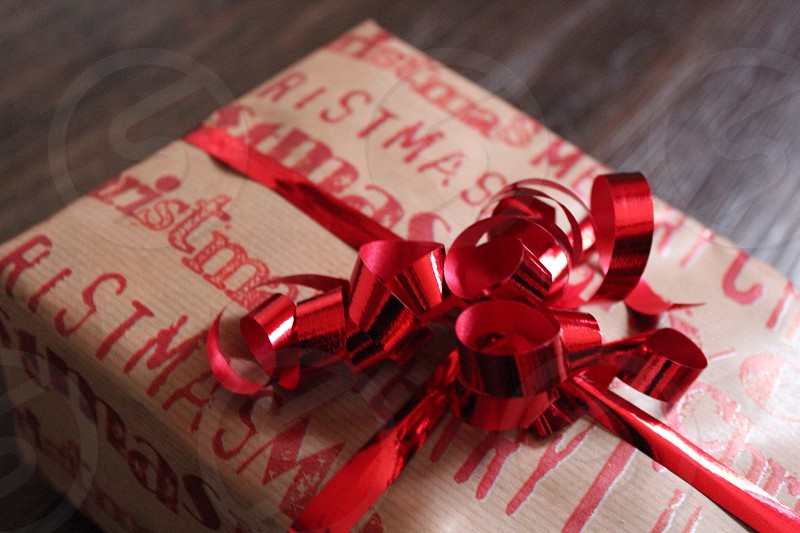 red ribbons on brown and red christmas print gift in tilt shift lens photo