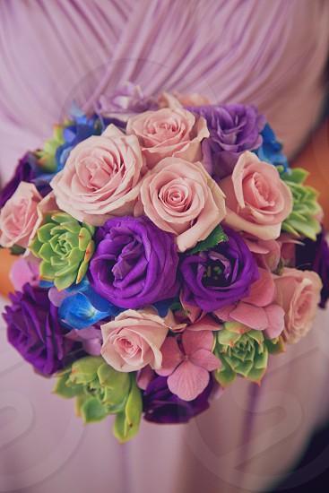 Women holding wedding bouquet  photo