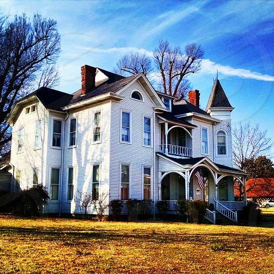 historic victorian blue sky clapboard cornices front porch mansion antebellum  photo