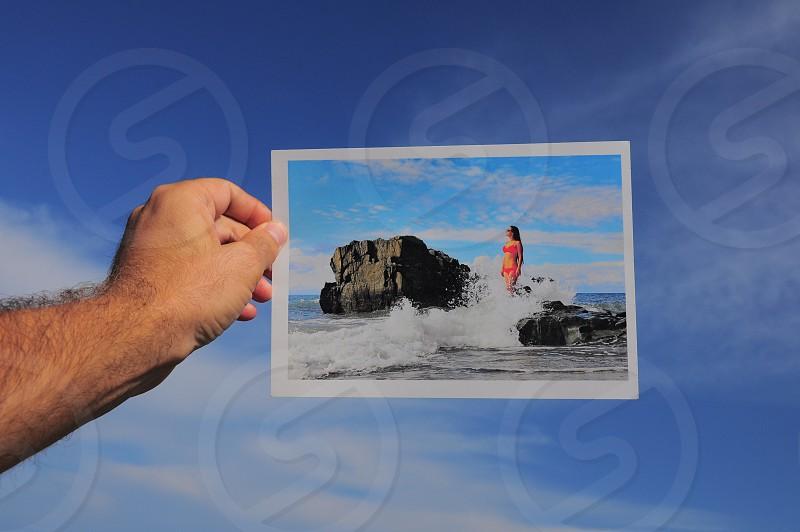 woman in 2 piece bikini on seashore rocks picture photo