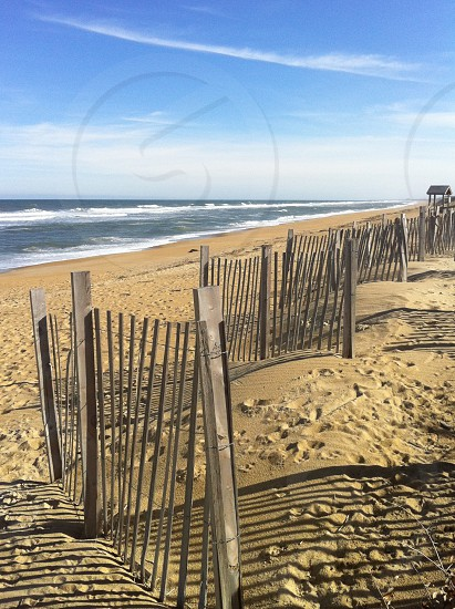 brown wooden fence on seashore photo