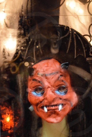 woman in demon mask photo