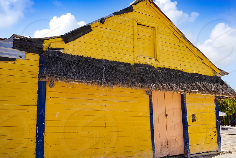 Holbox Island colorful yellow Caribbean houses in Quintana Roo of Mexico photo