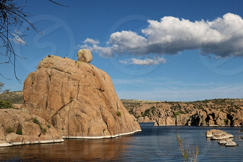Lake in Prescott Arizona is surrounded by smooth round boulder formations photo