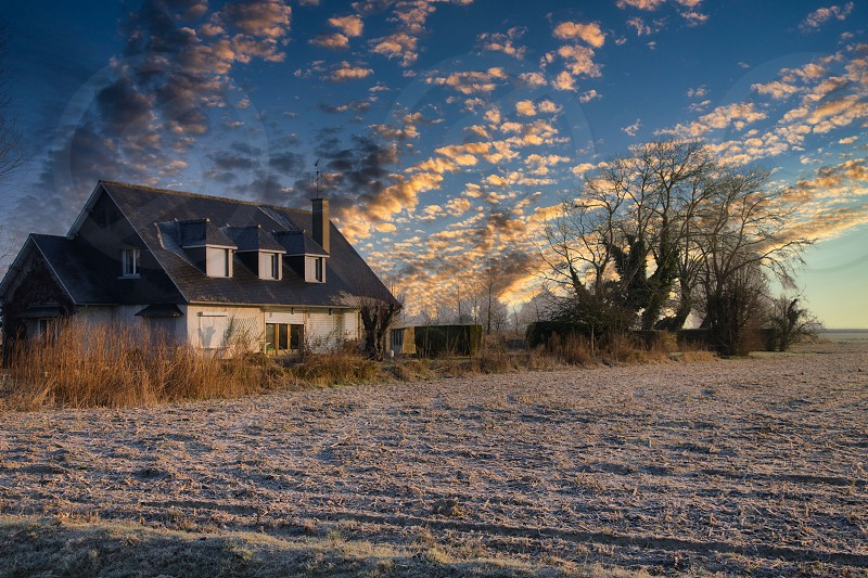 Cabin in the country in Mont Saint Michel shot during winter at sunrise photo