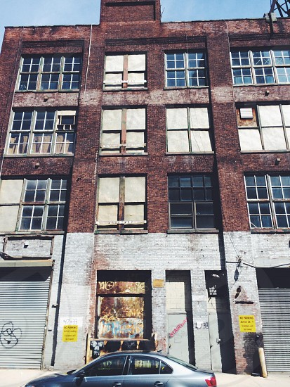 brick and cement building with paned windows photo
