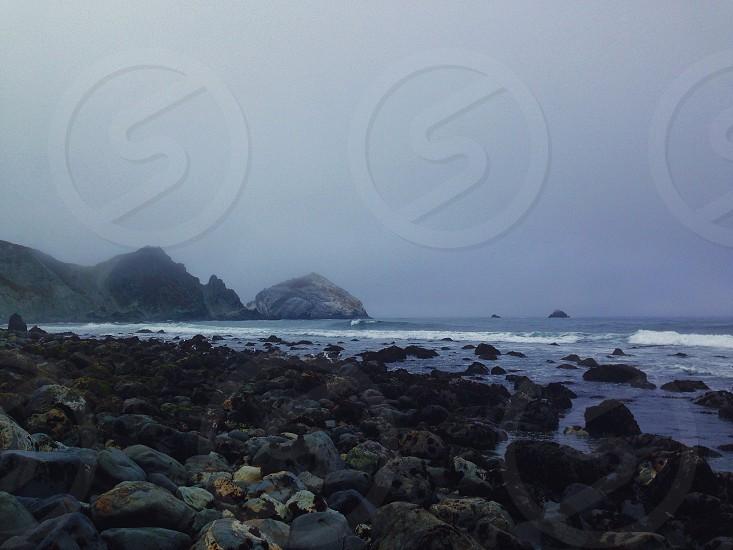 gray rocks by the seashore photo