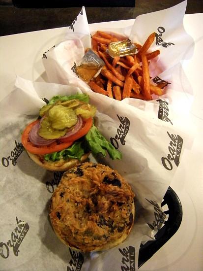 Deep fried hamburger patty with cheeseburger setup and sweet potato fries photo