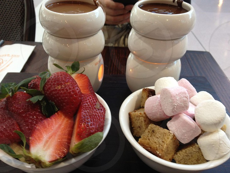 Chocolate fondue and assorted fruits at Max Brenner Chocolate Bar photo