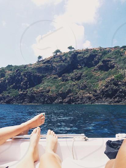 Boat . Relax . Sea . Island . Feet photo