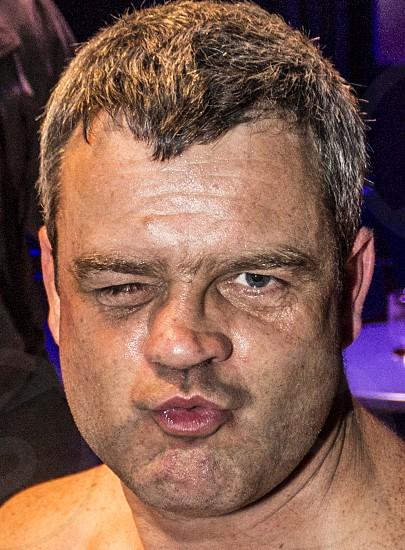 An old professional fighter blows a kiss photo