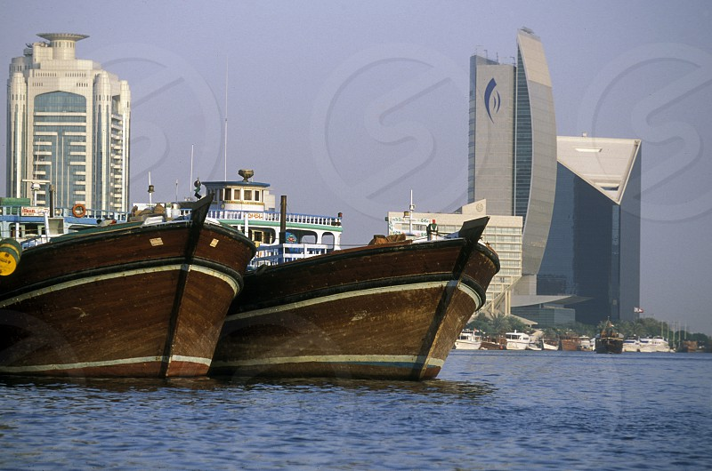Import and export goods at the harbour at the Dubai creek in the old town in the city of Dubai in the Arab Emirates in the Gulf of Arabia. photo
