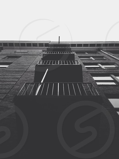Looking up at a fire escape. photo