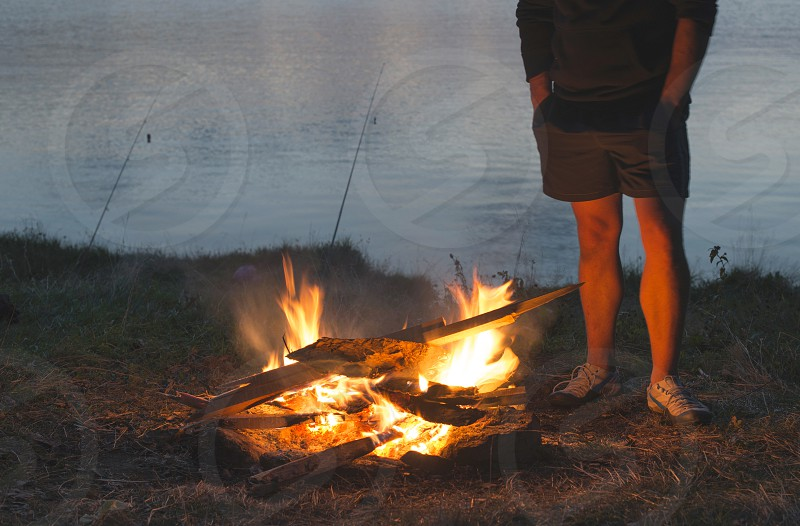 Fire in the nature. Preparing barbecue in the forest photo