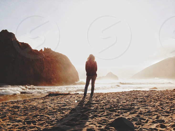 woman facing ocean silhouette  photo