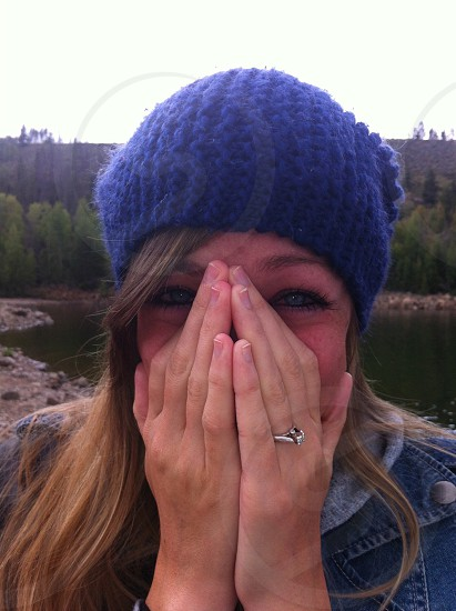 woman wearing blue crochet cap photo