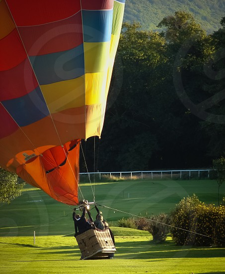 people in hot air balloon photo