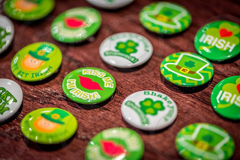 Macro shot of a group of Irish themed buttons. photo