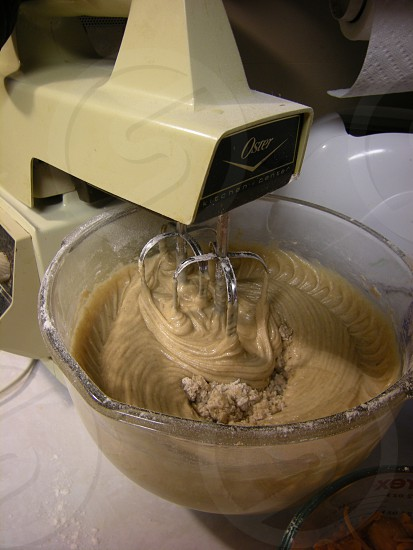 Old style mixer beating together cake ingredients photo