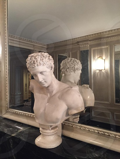 man's bust figurine in front of mirror photo