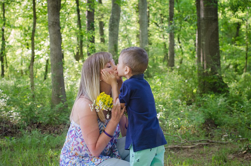 mother and son kiss flowers woods love family photo