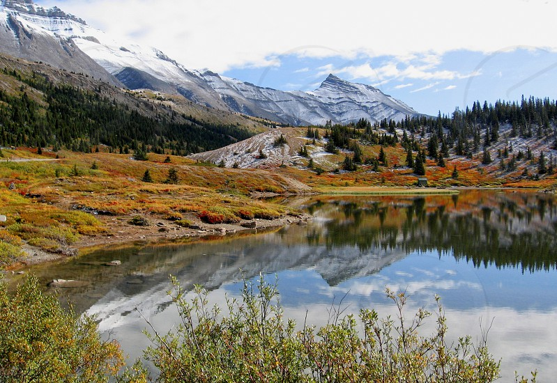 First fall snow at small lake near columbia icefield in Canadian Rockies (Jasper/Banff National Park). photo