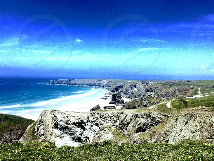 beach Cornwall ocean sea water cliff coast photo
