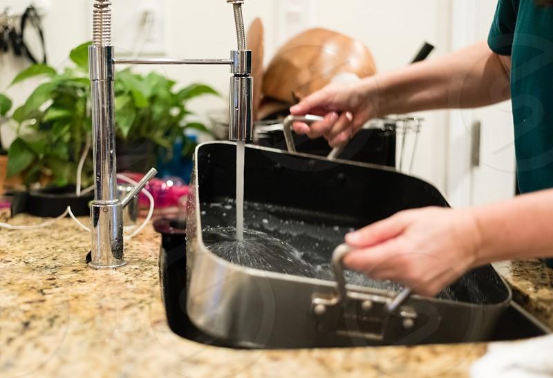 Washing the roasting pan photo