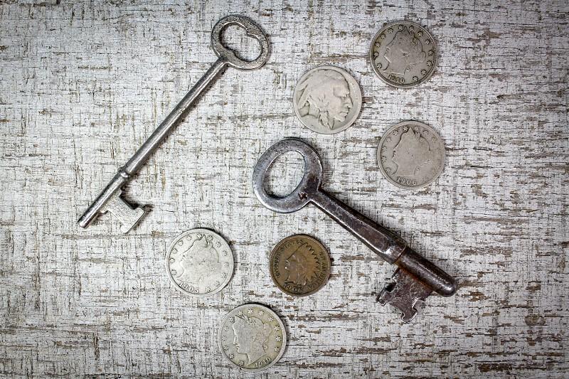 Coins keys penny nickels financial finance money vintage spending change pocket photo