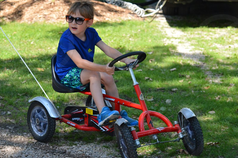 girl in blue t shirt riding cart photo