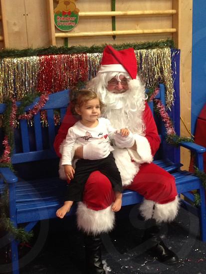 girl sitting on santa's lap photo