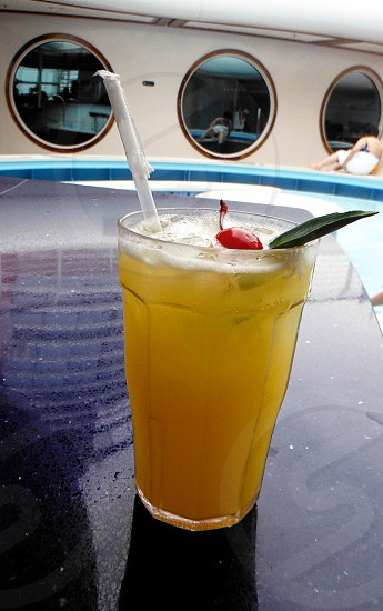 Tropical cocktail at the pool photo